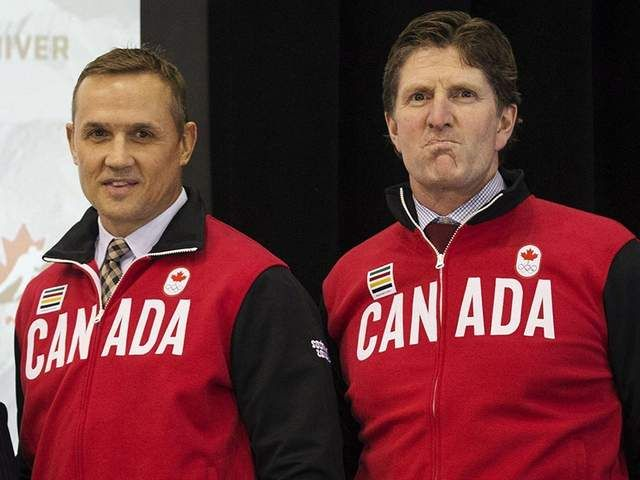 Team Canada general manager Steve Yzerman and coach Mike Babcock.