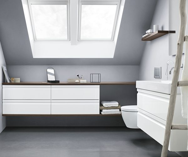 Wall-to-wall functionality using the space under sloping walls in a small bathroom upstairs.