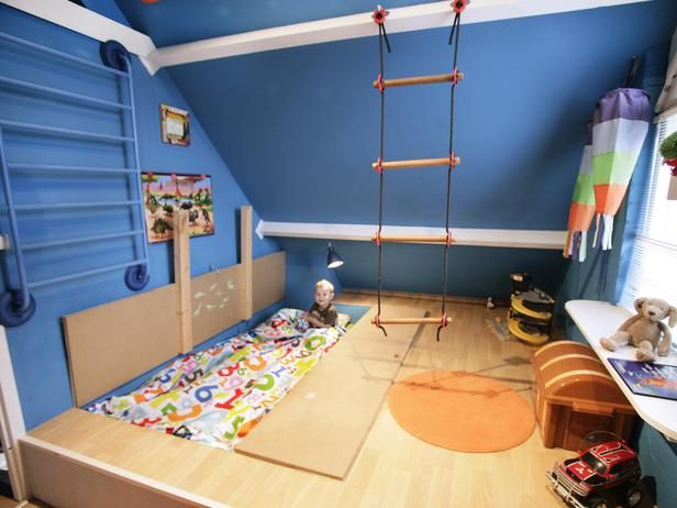 A bed tucked under 'trap doors' in the floor - makes for a flat play area during the day! (Kids' Playroom Design Ideas : Rooms : Home & Garden Television)