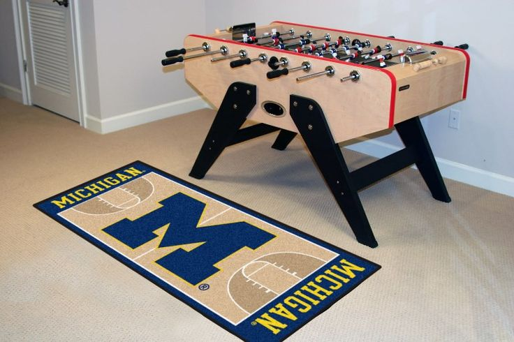 Customize any room in your home or office and show your team pride with this University of Michigan Basketball Court Runner by Fanmats. The nylon mat is chromojet painted in the team colors and decora