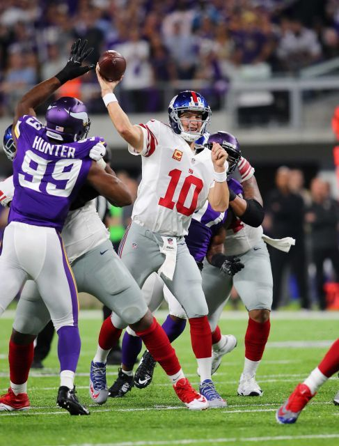 Monday Night Football: Giants vs. Vikings:   October 3, 2016  -  24 - 10, Vikings  -    Eli Manning of the New York Giants throws the ball in the first half of the game against the Minnesota Vikings on Oct. 3, 2016 at U.S. Bank Stadium in Minneapolis.