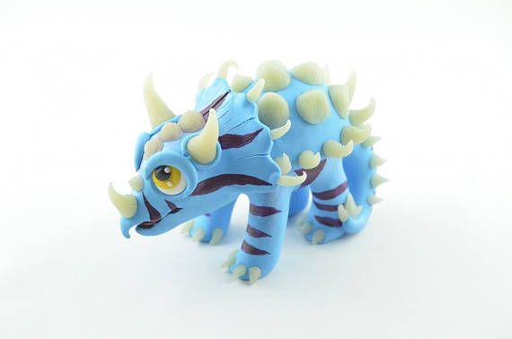 direhorn hatchling handmade figurine, hearthstone inspired dinosaur, polymer clay handcrafted sculpture, blue dino art, clay dinosaur