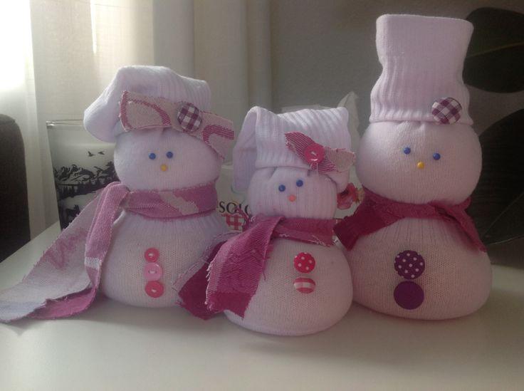 Sneeuwpoppen van sokken.