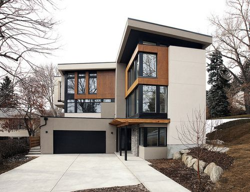 I like the mix of wood and concrete, the angles and all the windows.