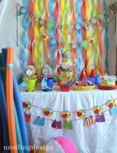 Beach Ball Pool Party Reveal! Favor Table. Love the bright colors!