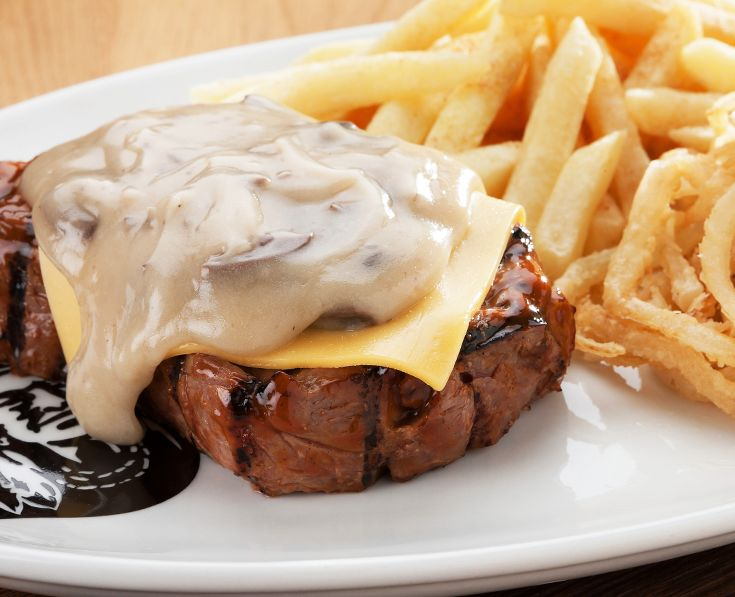 Cheddamelt Steak: Topped with melted cheese and mushroom sauce or pepper sauce. https://www.spur.co.za/menu/steaks/