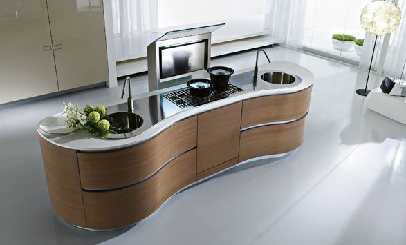 Dune kitchen by Pedini  is defined by asymmetrically curved base units echoing flowing forms found in nature