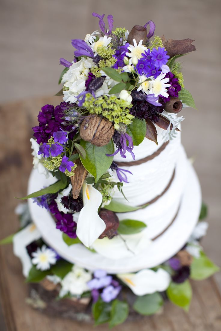 Add an enchanting tale with your cake display by nestling the creation atop vibrant foliage. Drape fresh blossoms over the tiers and use a slice of moss-laden natural timber in place of a cake stand. New Zealand Weddings Magazine, Spring 2013 issue. Photography by Jimena Murray.