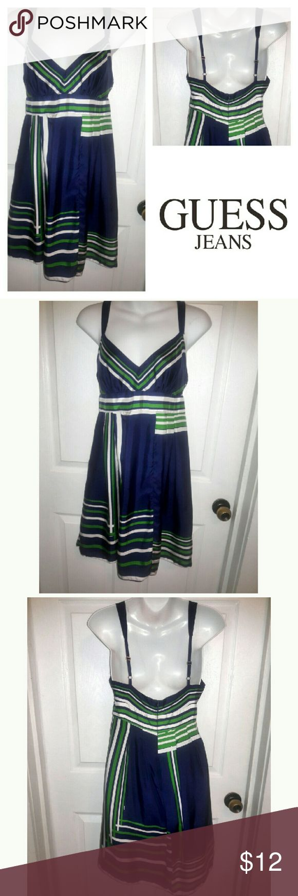 100% Silk Guess Jeans blue and green dress 100% silk, Guess Jeans blue and green dress. Good condition. Two flaws pictured. One thread popped from right strap and two tiny pulls you don't notice. Adjustable straps with gold hardware. Very cute dress. Fully lined with chiffon style fabric. Size 7 Guess Dresses