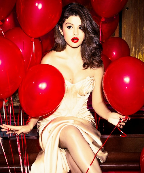Can't get over Selena Gomez. Love this glamorous picture! Red balloons & dress for the perfect Bday look.
