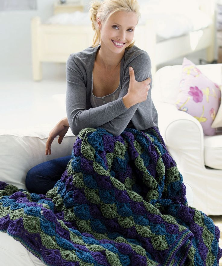 The classic shell design adapts to any room with your choice of color. Crochet it as shown, in colors to complement your room or use up your yarn stash and make It in many colors.