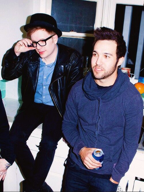 Pete wentz and patrick stump. Best buds. Haha patrick is sitting on the counter