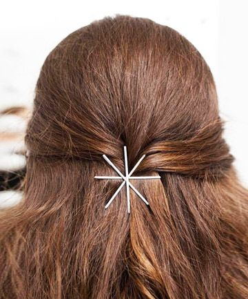 Use your bobby pins to elevate a simple hairstyle like this half updo