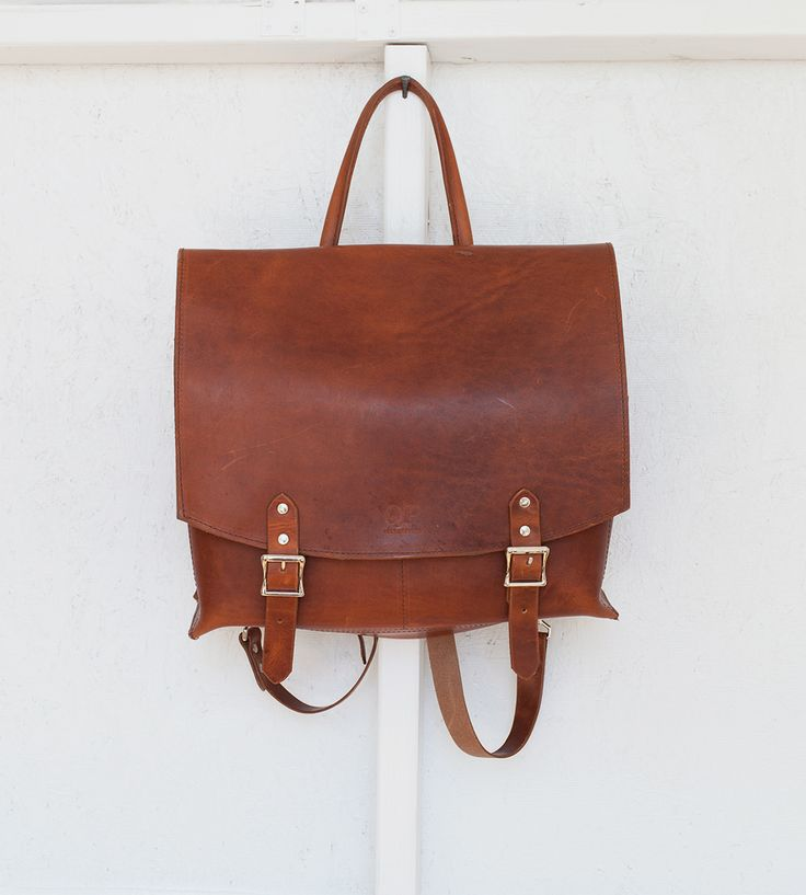 Leather & Canvas Messenger Backpack | Whether you carry it as a backpack or over your shoulder, this... | Backpacks