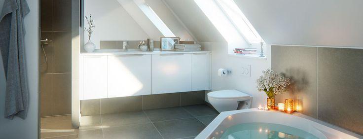 Sådan kan et badeværelse se sig godt ud med skråvægge. Badeværelse-interiør ved rækkehusprojekt i Ishøj Landsby, Kirkebjerggårdsvej, fra Lind & Risør.