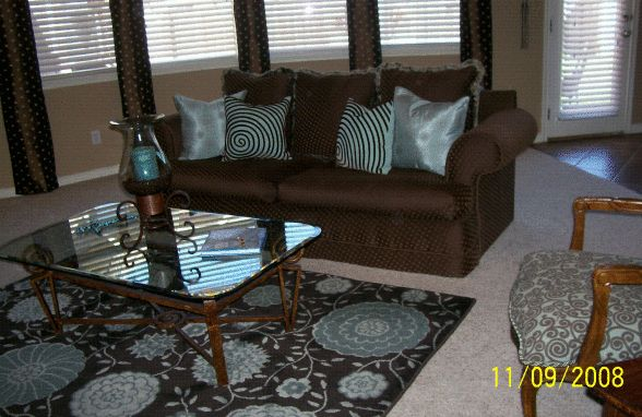 Blue/Brown Living Room, I'm always looking for ways to decorate on a tight budget!  The walls are painted with Wal-Mart/Kilz (Gaucho); I reupholstered an old sofa and chairs I purchased the coffee table off Craigslist for $50; the urns beside the TV armoire were bought from a roadside vendor for $70 because one of them had a small chip which I turned to the back; the scrolls beside the Armoire were stenciled from an old wrought iron piece I had.  Check out my blue/brown dining room…