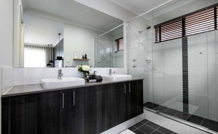 Ensuite featuring double sized shower, twin vanity basins and separate WC