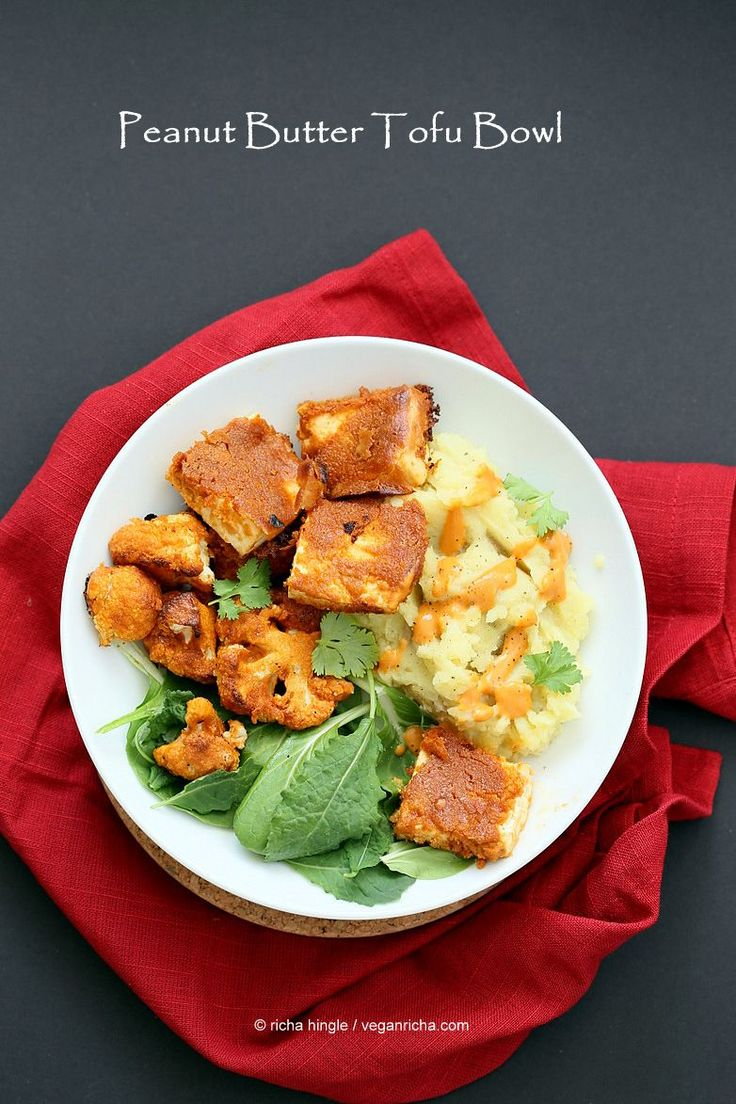 This Peanut Butter Tofu bowl is super easy. Bake the tofu with Peanut sauce, prep the best ever Vegan Mashed Potatoes and kale salad. Serve. Glutenfree Vegan Recipe