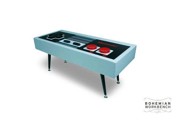 Nintendo controller coffee table that actually works! Fun Design Ideas We Love at Design Connection, Inc.   Kansas City Interior Design http://www.DesignConnectionInc.com
