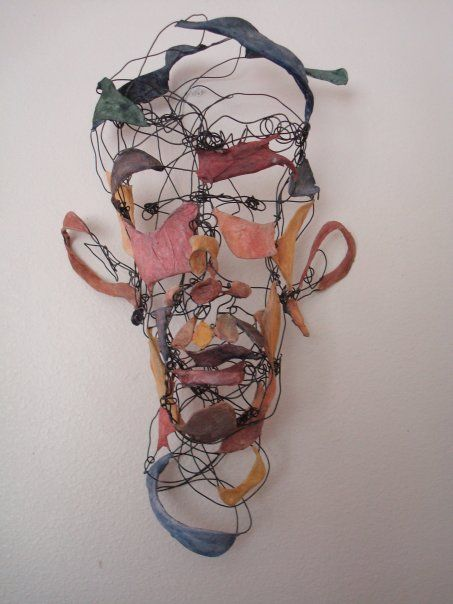 blind contour drawing translated as wire sculpture