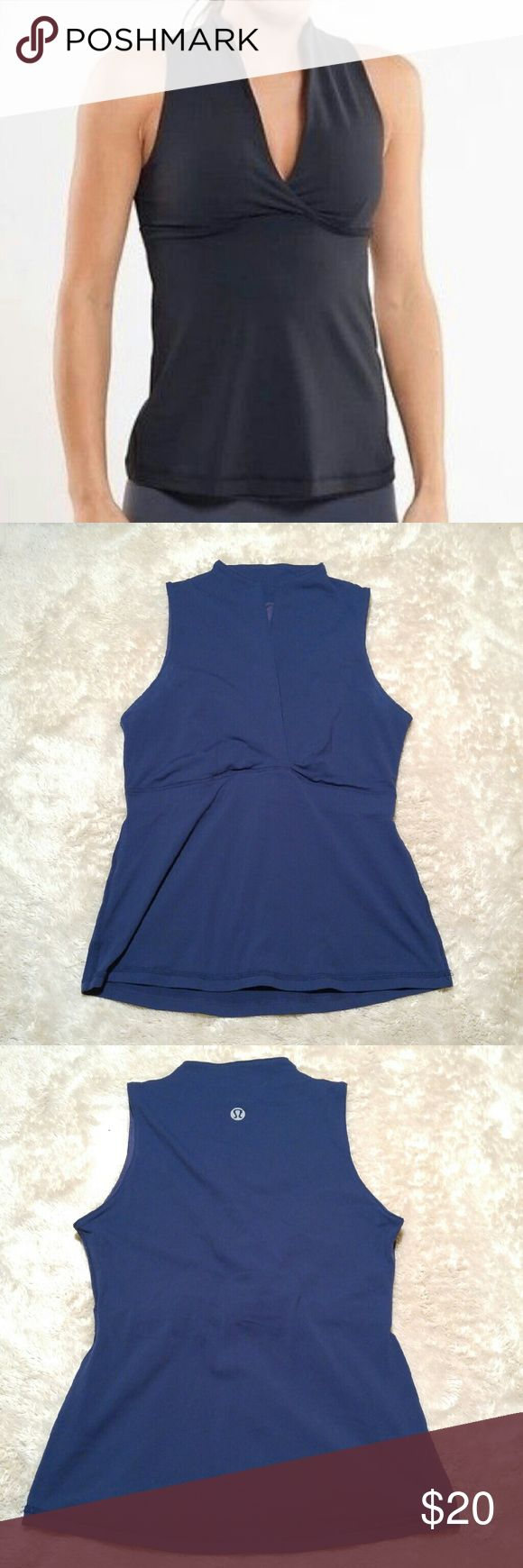 "Lululemon Athletica Navy Whisper Tank Top Lululemon Athletic navy whisper tank. Pre loved but still in great condition! Only flaw is the label coming off from washing. Color is navy like the stock photo, it photographed brighter than it is.  Approximate measurements Armpit to armpit 17"" Shoulder to hem 23"" lululemon athletica Tops Tank Tops"