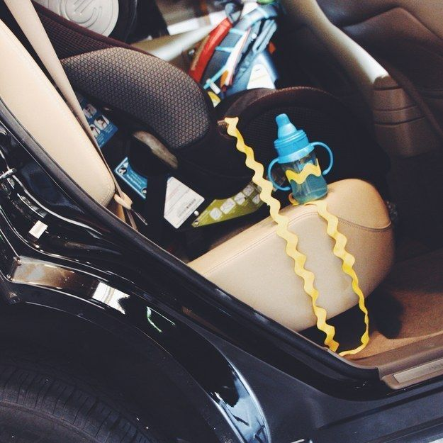 Attach a sippy cup to your kid's car seat so you won't have to turn around and pick it up every single time they drop it.