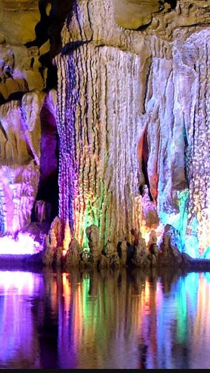 Reed Flute Cave, Guilin, China.  This natural limestone cave in China is over 180 million years old (though the colorful lighting is a bit more recent). Fun fact: Ink inscriptions on the cave walls have been dated all the way back to 792 AD, and tell us that the cave was an attraction even then.