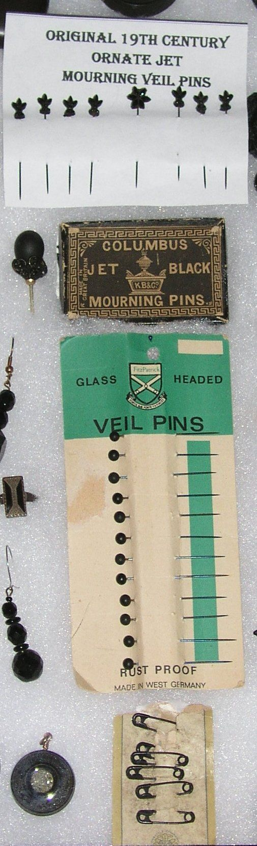 19th century black mourning pins. As it was unseemly for a woman in mourning to wear anything that shone, dull black mourning pins secured clothing.