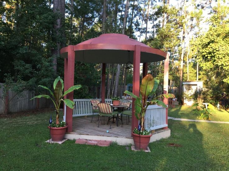 Here is What We Did With an Old Satellite Dish. It is 12 Foot Around, - Turned an old satellite dish upside down, on 4 x 4 posts, painted it. Got it free from t...