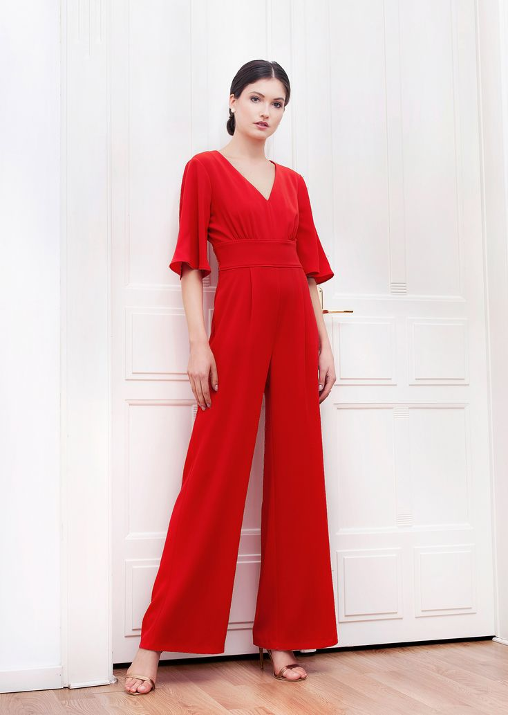 Adelle Jumpsuit. The long silhouette, the rich red, the volume of the sleeves and the ties at back create a strong, memorable piece. Youthful, modern, feminine and relaxed. Wear it with high heels and own the night.