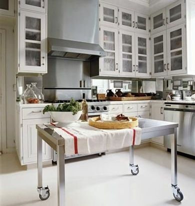 Invest in multipurpose furniture, such as a stainless steel table on casters that can be wheeled into position—as a prep station, dining table, etc.—as needed.