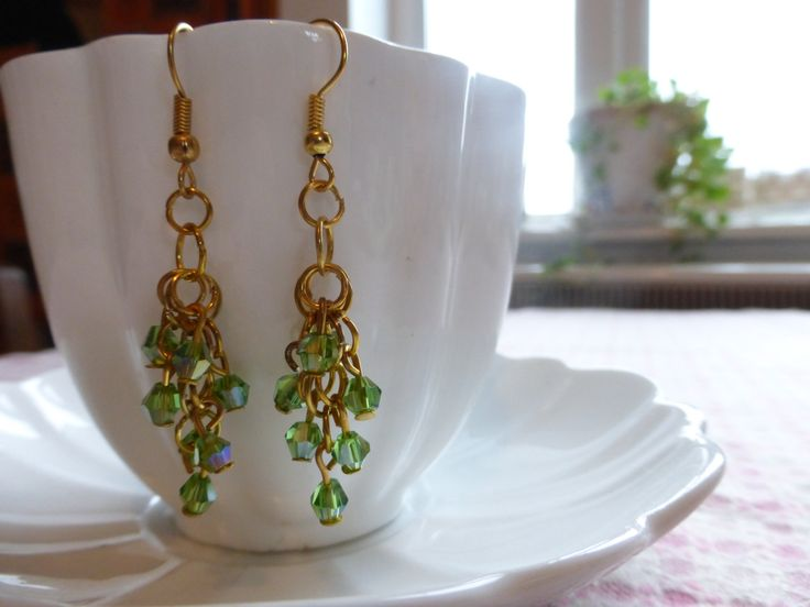 Earrings: green crystal bead dangley cluster by TheCatAndTheClasp on Etsy
