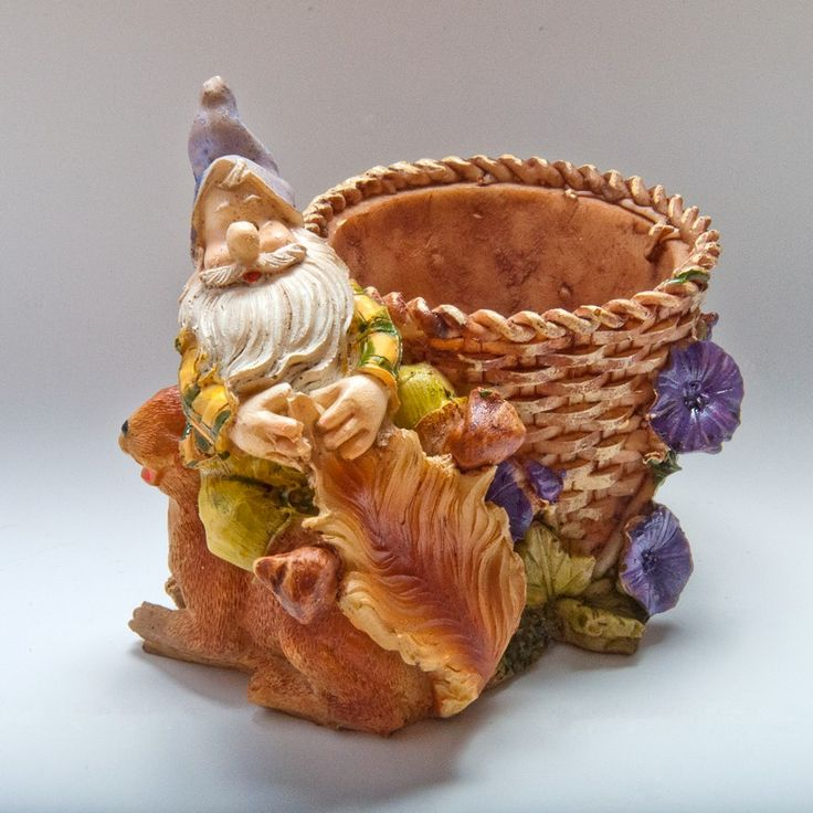 Dwarf with basket and squirrel
