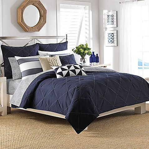 Transform your bedroom into a soothing sanctuary with the Nautica Reversible Lawndale Coverlet. Adorned with a beautiful ivory diamond quilt stitch on a navy background, the simplistic coverlet is the perfect complement to the calming bedding.
