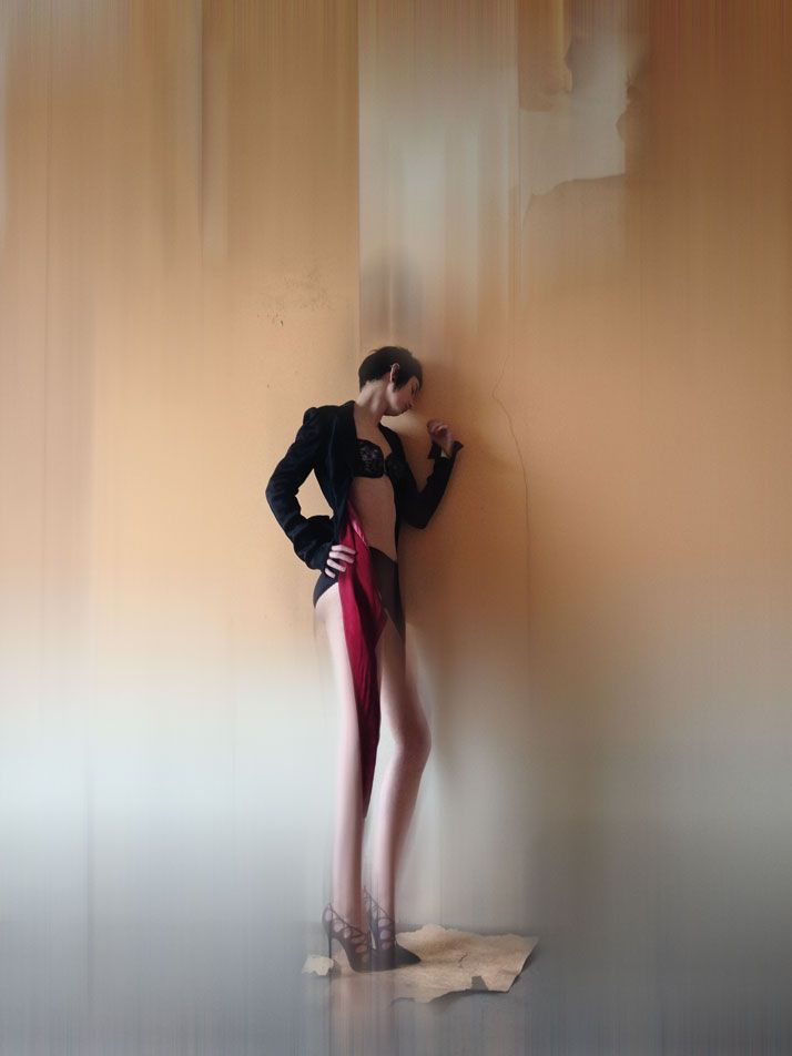 'Isabella Blow: Fashion Galore!' At Somerset House  Jacket: Alexander McQueen, Central Saint Martins MA Fashion Collection 1992. Duchess satin jacket with boned bustle back and points at the front, silk.  Underwear: Rigby & Peller.  Shoes: Manolo Blahnik.  Model: Alexia Wight.  photo © Nick Knight.