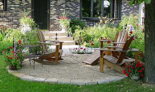 patio idea. crushed gravel and stone with stone border