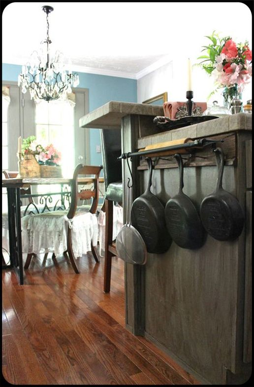 The Old Painted Cottage - November 2013.  Cast iron skillets hanging on wood shelf and old nails.