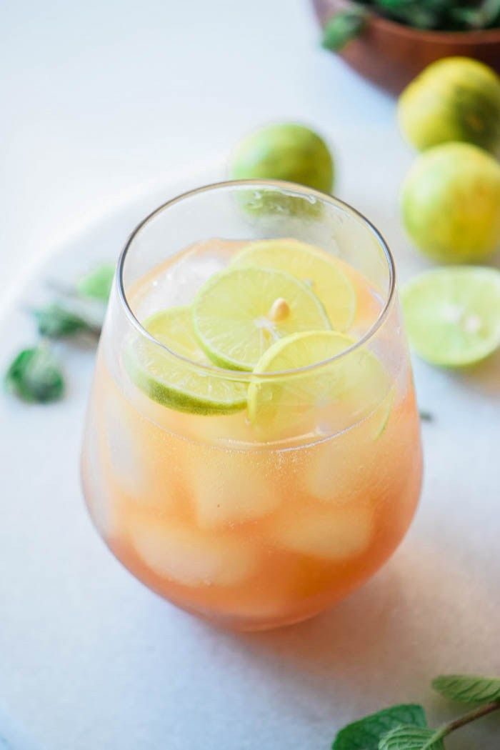 Lime Shandy Beer Cocktails Recipe perfect for summer cocktail party with limes, lime soda, dark beer and ice - light drink recipes