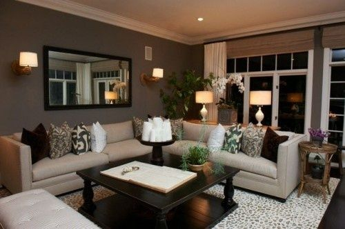 Grays, browns and neutrals living room. Love those sconces!