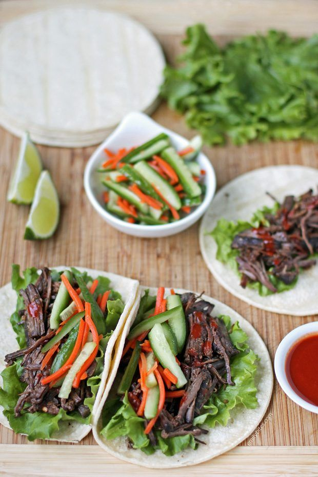 These Slow Cooker Korean-Style Beef Tacos from Skinnytaste Fast and Slow are easy and perfect for a gourmet taco night. Two tacos are just 302 calories or 7 Weight Watchers SmartPoints! www.emilybites.com