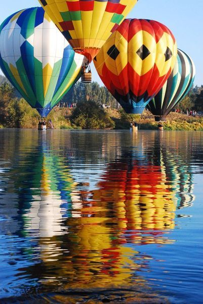 Hot air balloons and their reflections
