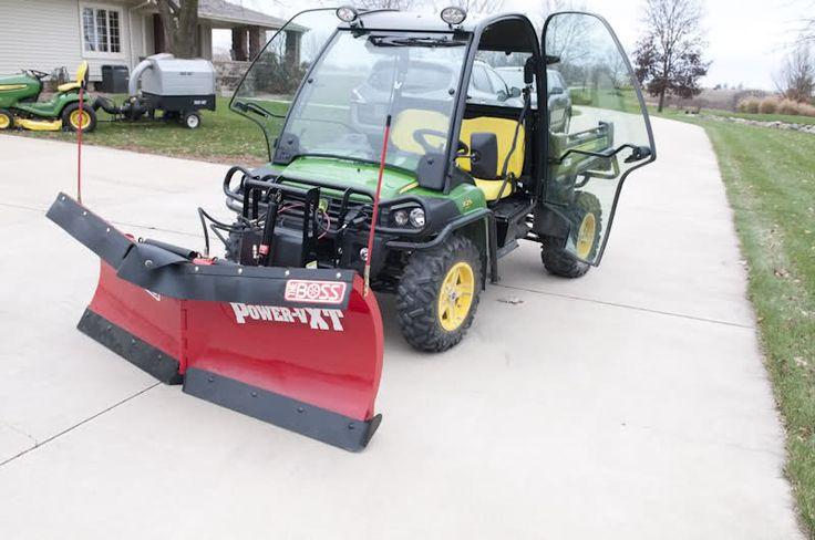 John Deere Gator w/ Boss snow plow installed on 825i