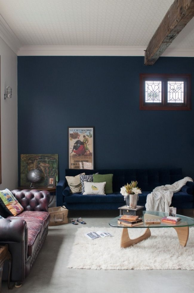 Etica Studio - The Recycled House | House Nerd - love the ceiling beam and dark blue wall