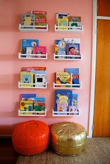 spice racks attached to wall for book storage, love the bean bag chairs under racks
