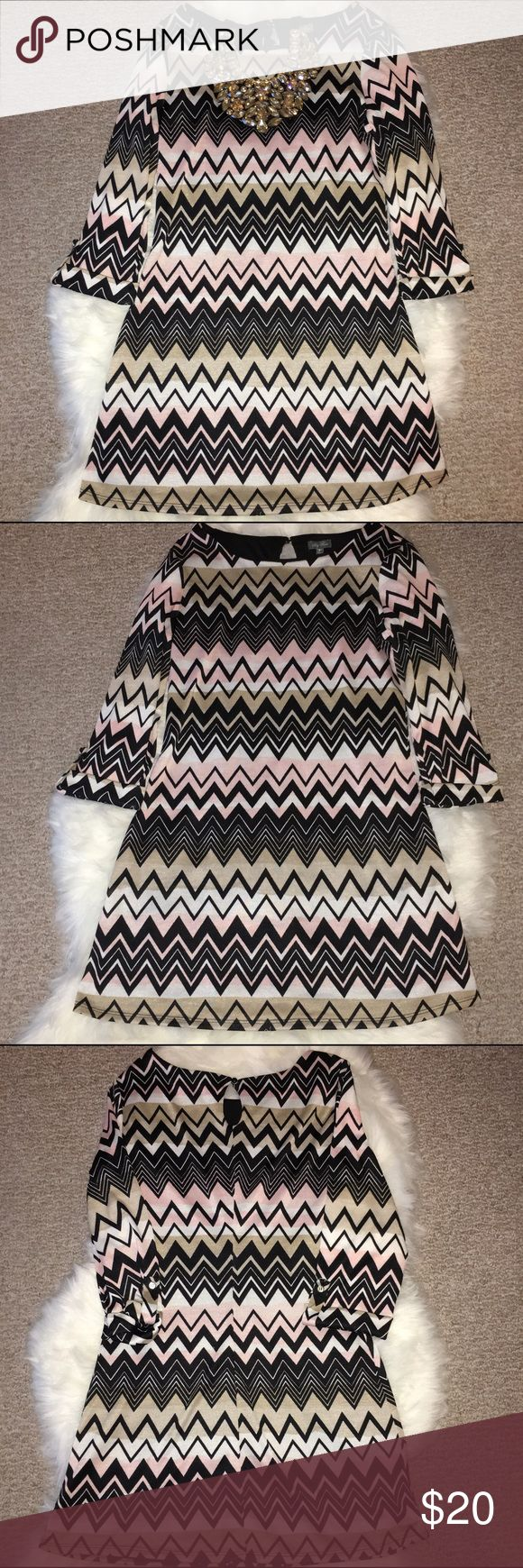 "NWT‼️ Lily Rose Zig-Zag Mini Dress - SZ: M NEW WITH TAGS. - This is a gorgeous long Sleeve mini dress by Lily Rose. Pink, cream & white with black zig-zag designs going across. Approx. 32"" inches long. Cotton. Simply beautiful. **Please ask all questions prior to purchasing.** Lily Rose Dresses Mini"