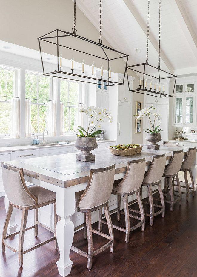 glass iron pendant lights, kitchen island, timber upholstered armchairs