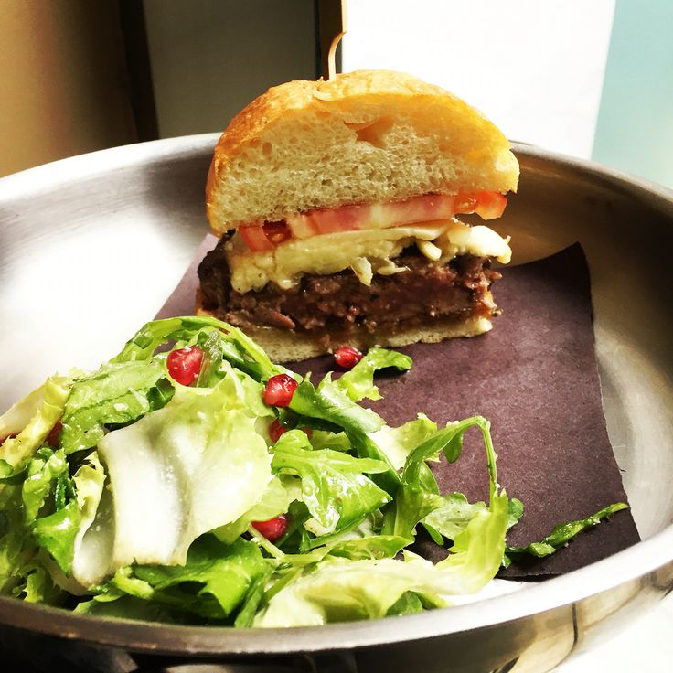 A gorgeous inhouse ground organic sirloin burger with double aged cheddar