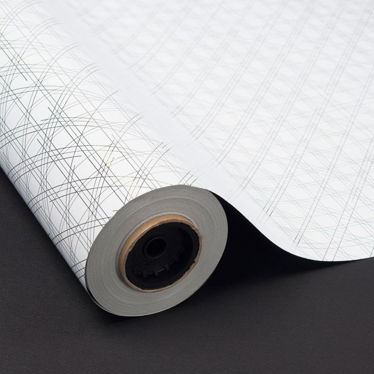 - Material: Papel metalizado - Diseño: Cuadrícula - Color: fondo blanco