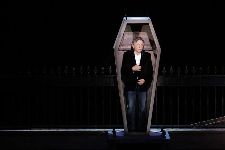 """Mar. 17, 2014. Polish-French film director Roman Polanski stands in a coffin as he takes part in the presentation of the musical """"Le Bal des Vampires"""" (Dance of the Vampires) at the Mogador theatre in Paris."""