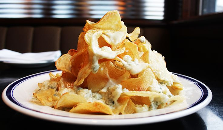 Fewer dishes reflect Buckhead Life Restaurant Group's long history than the warm Maytag blue cheese chips offered at Buckhead Diner.